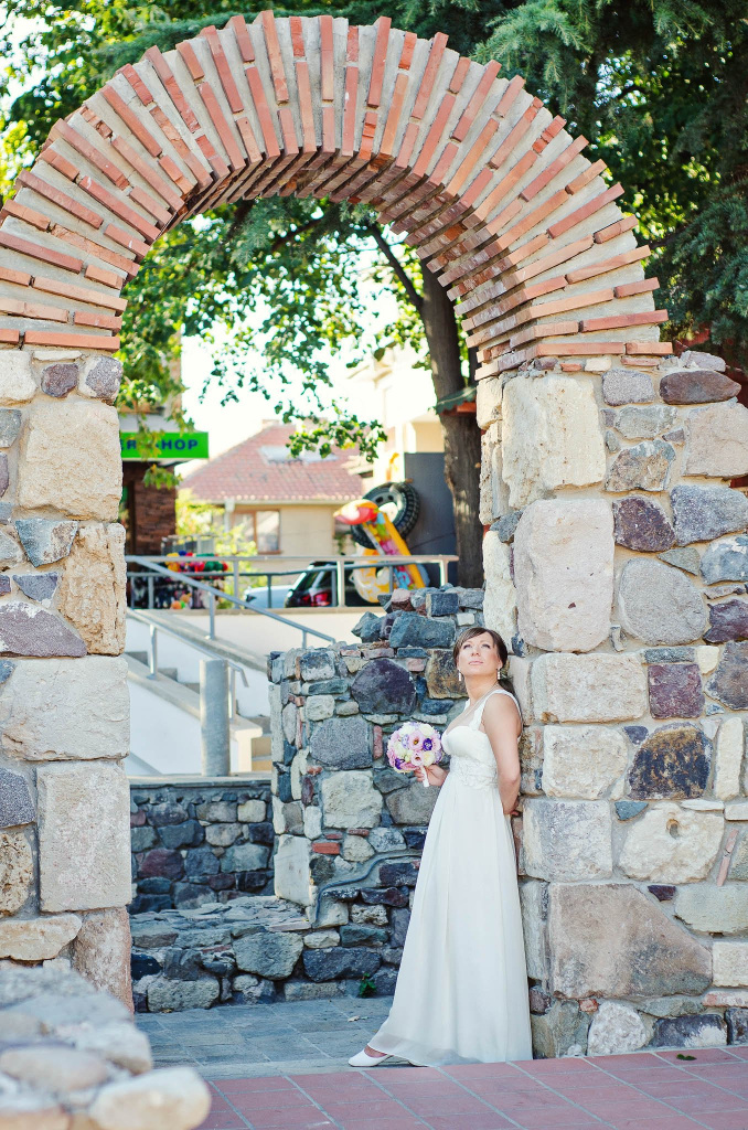 Bridal portrait near an ancient fortress
