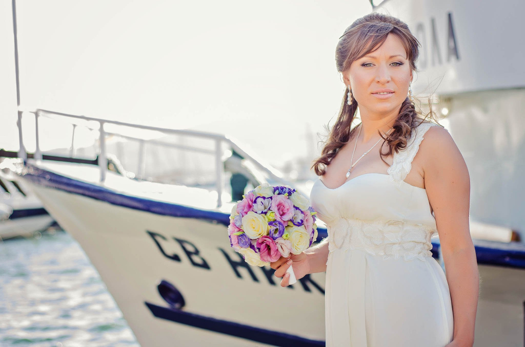 Bridal portrait in front of a boat