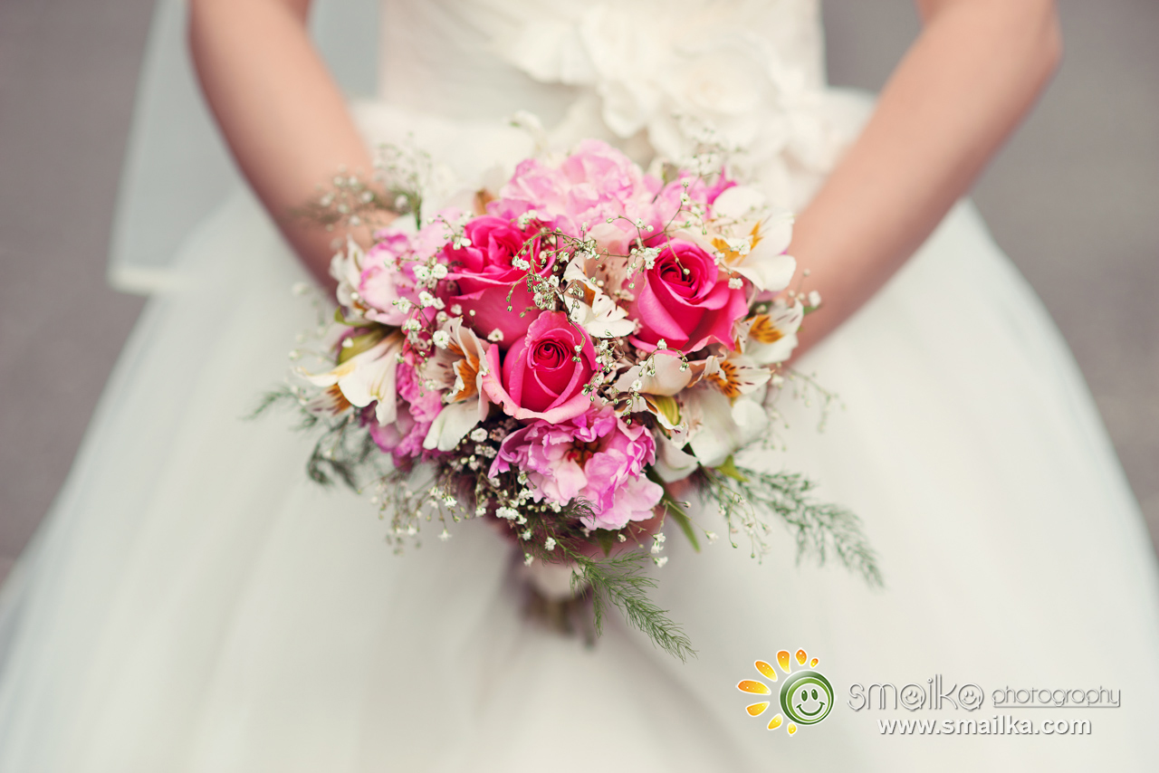 Wedding photosession bride holding the wedding bouquet