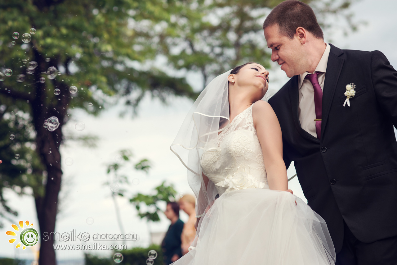 Wedding photography bride and groom looking at each other