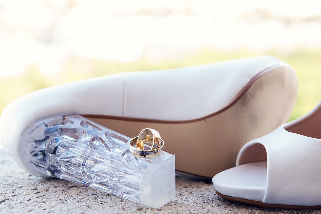 Wedding rings and bride's shoes