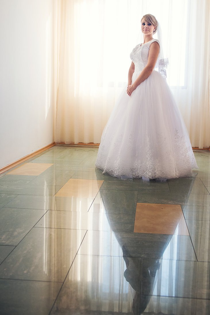 Reflection of a bride in her wedding dress