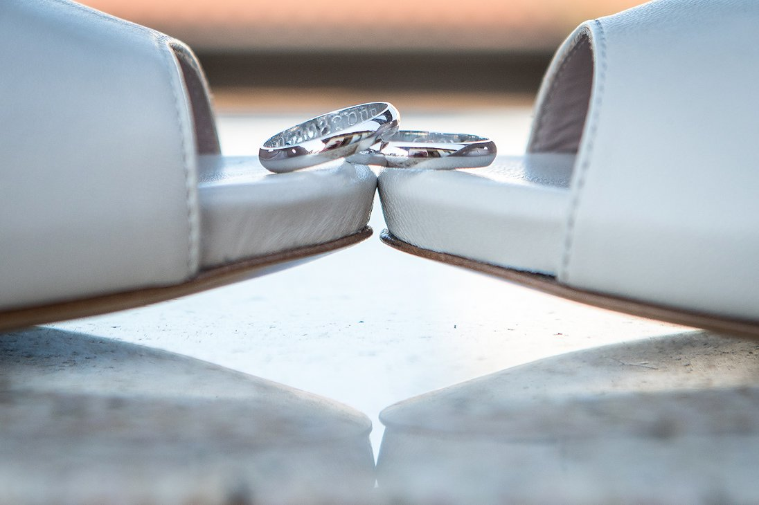 Wedding rings and shoes close up photo