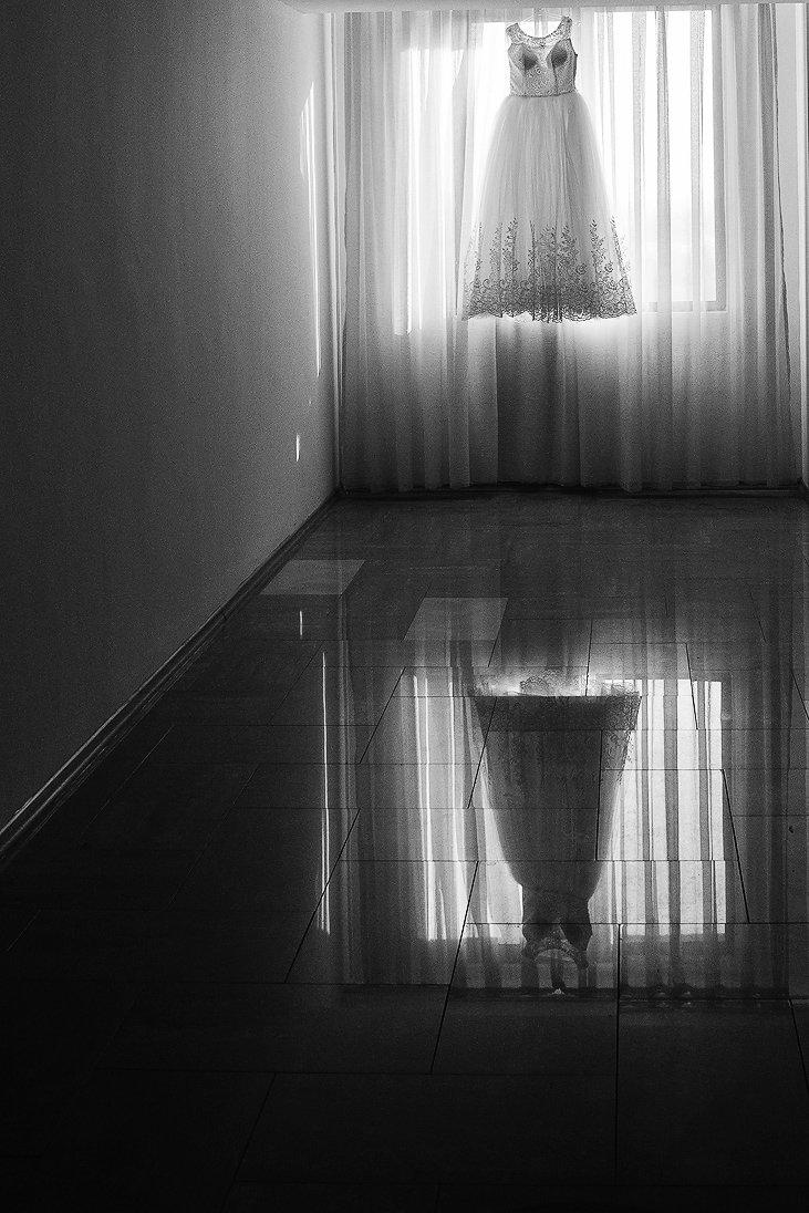 Wedding dress hanging reflection