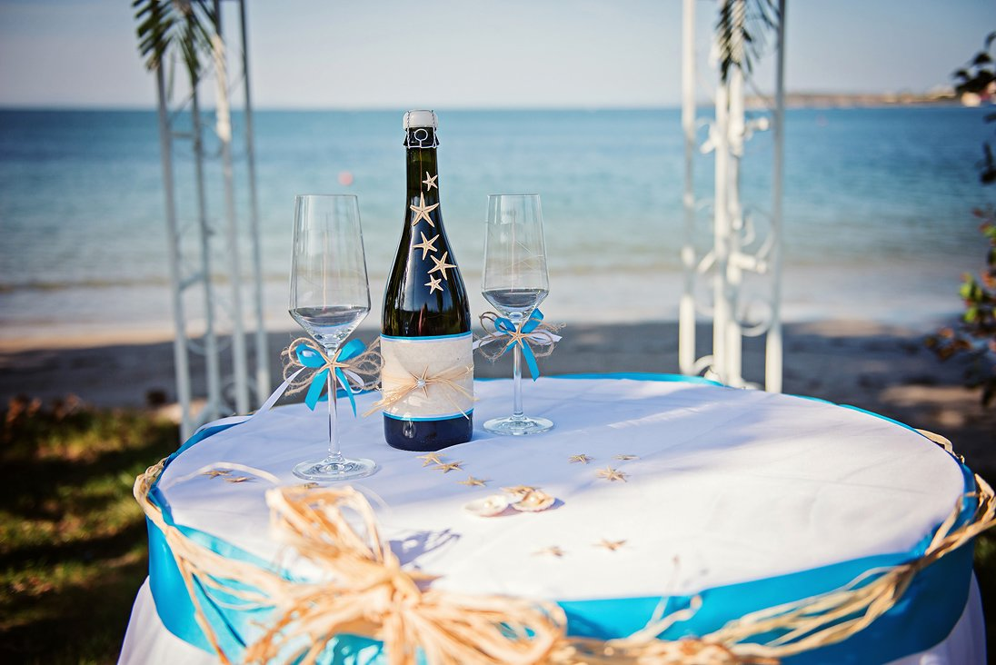 Wedding arc and wedding glasses on the beach