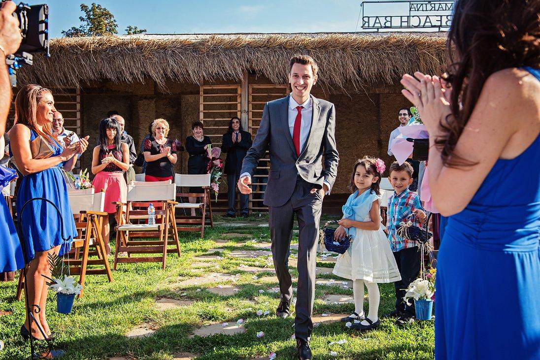 The groom walking