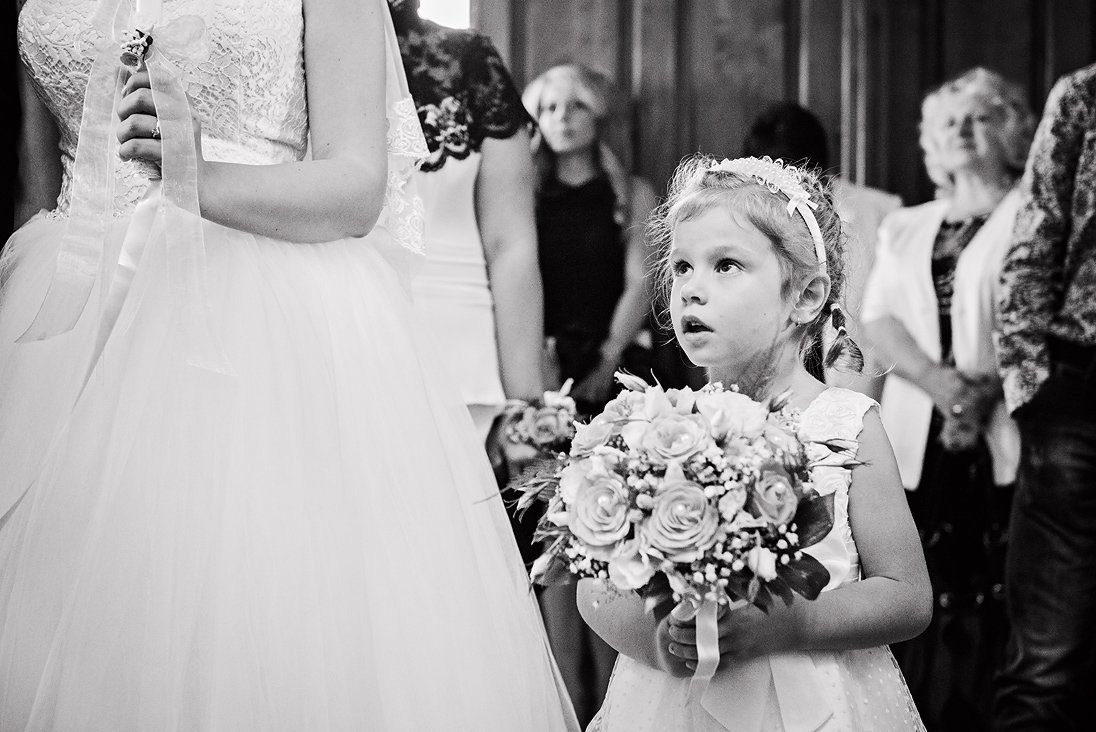 Kid holding the wedding bouquet in a church wedding