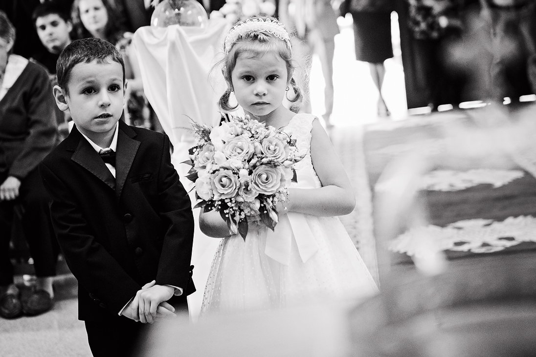 A photo of kids holding the wedding bouquet in a Plovdiv church