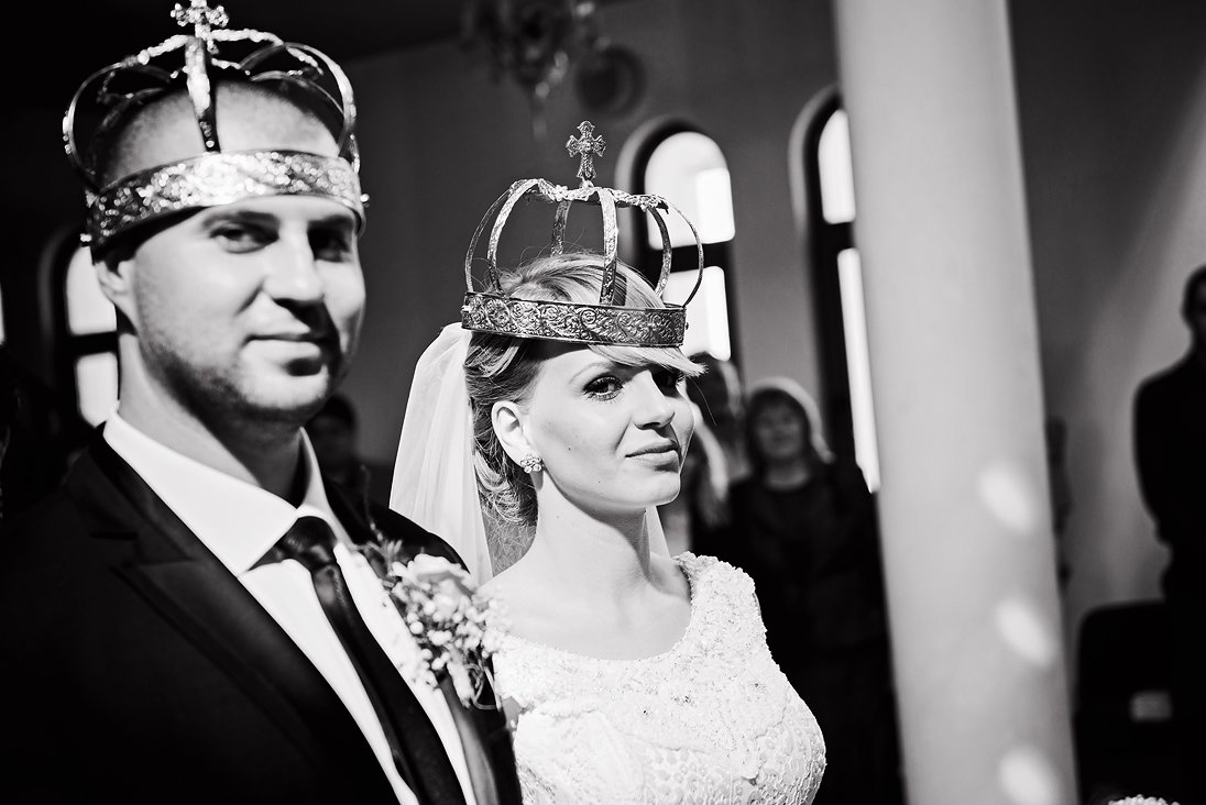 Bride and groom with wedding crowns