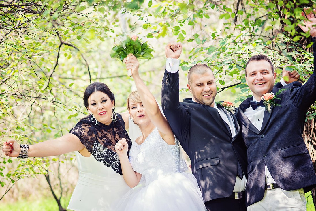 Wedding couple and friends expressing joy
