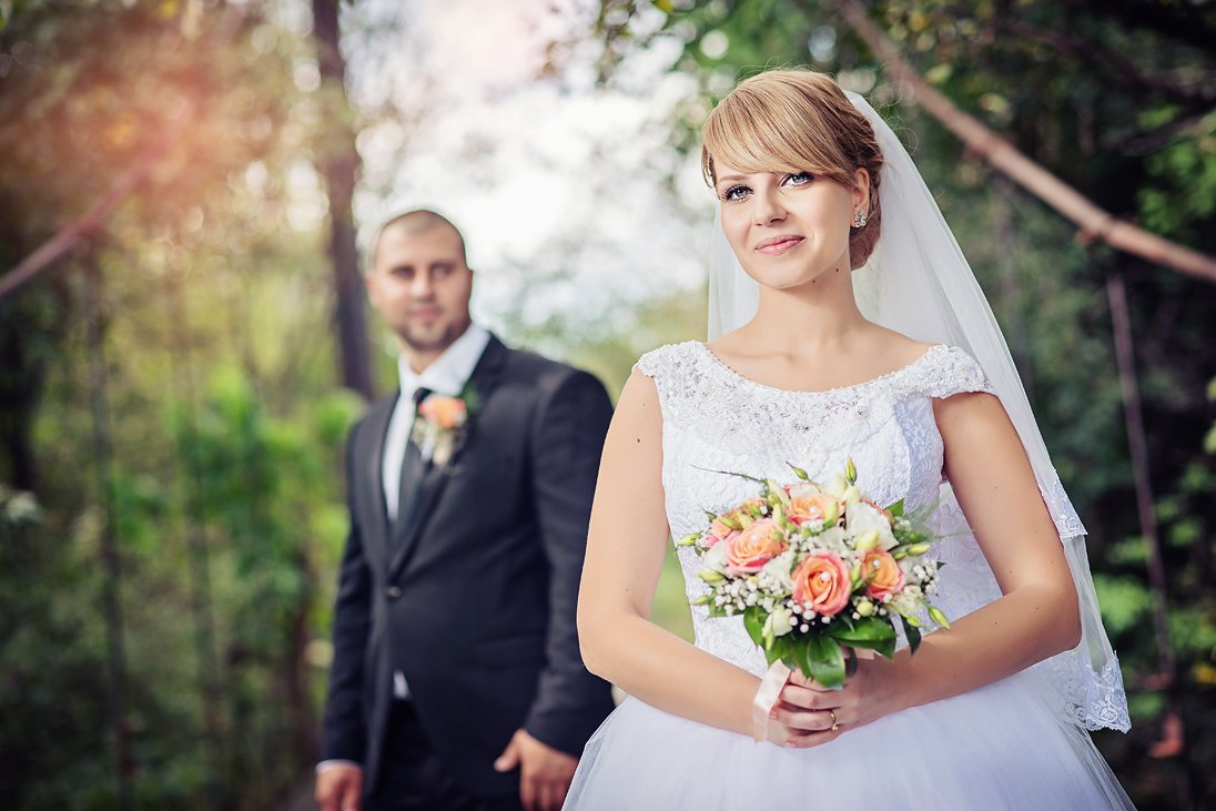 Bride in front of the groom in a wedding portrait in Plovdiv