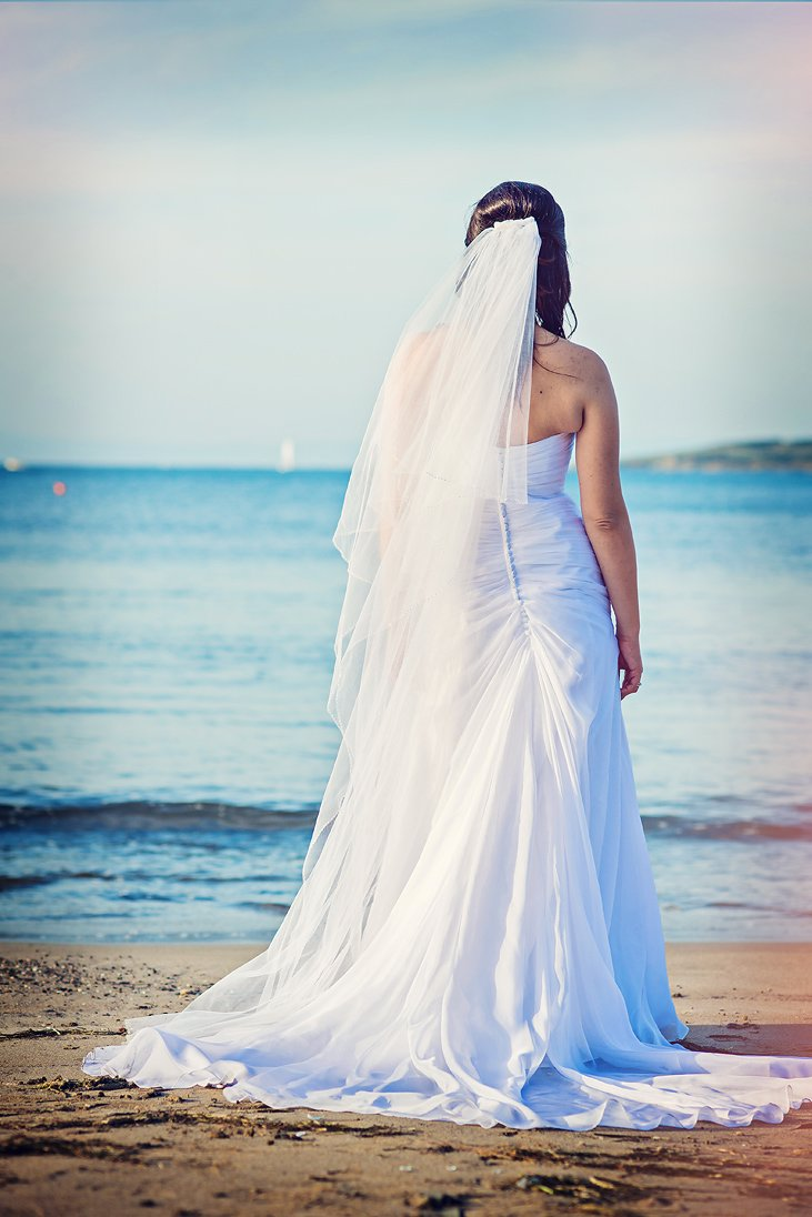 Romantic photo of a bride by the sea