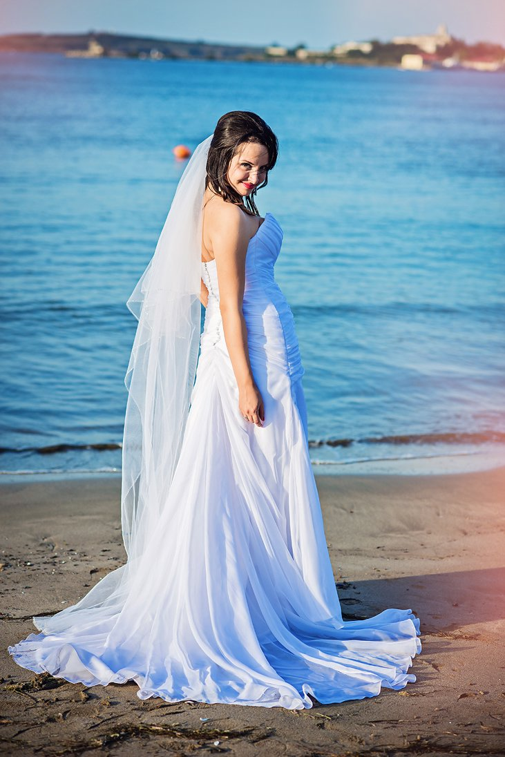 Bride portrait by the sea in Santa Marina, Bulgaria