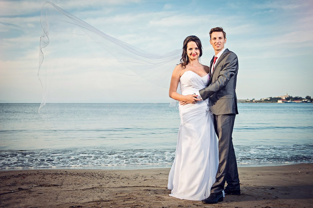 Wedding couple portrait by the sea