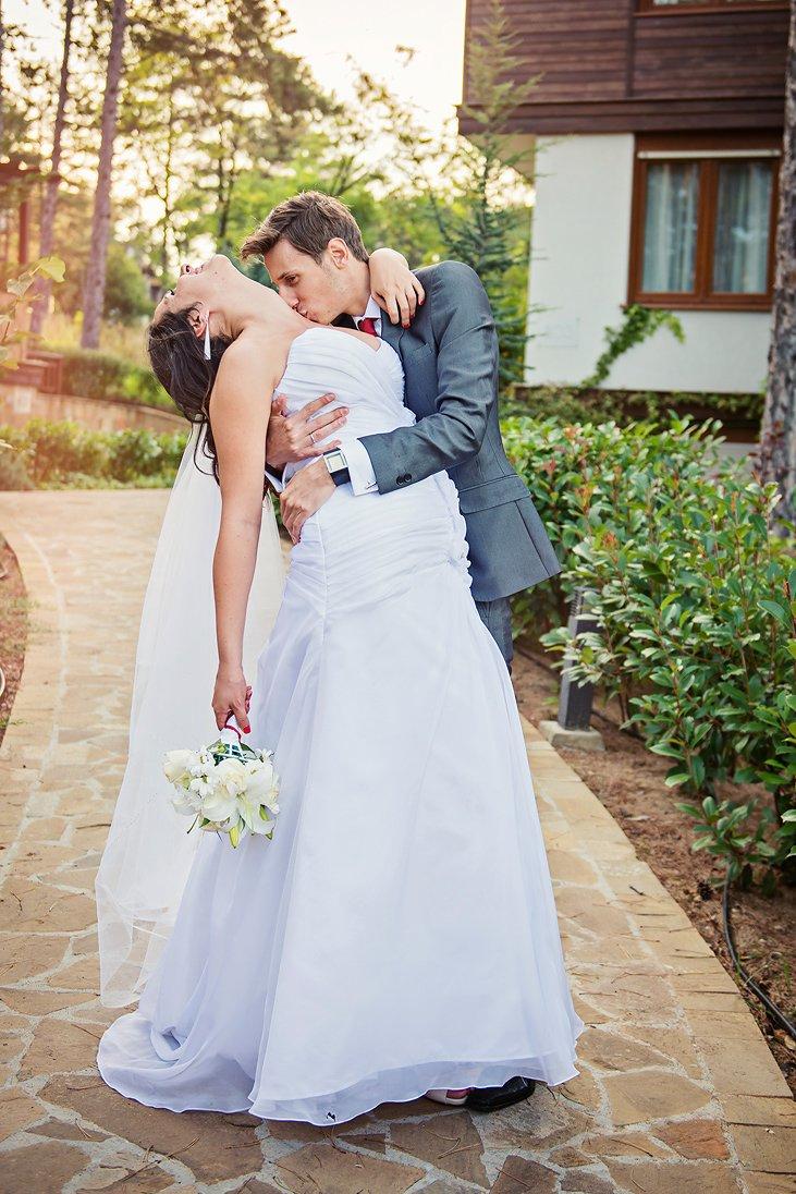 Groom kissing passionately the bride in Santa Marina
