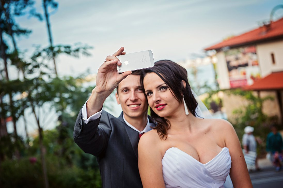 Bride and groom taking selfies