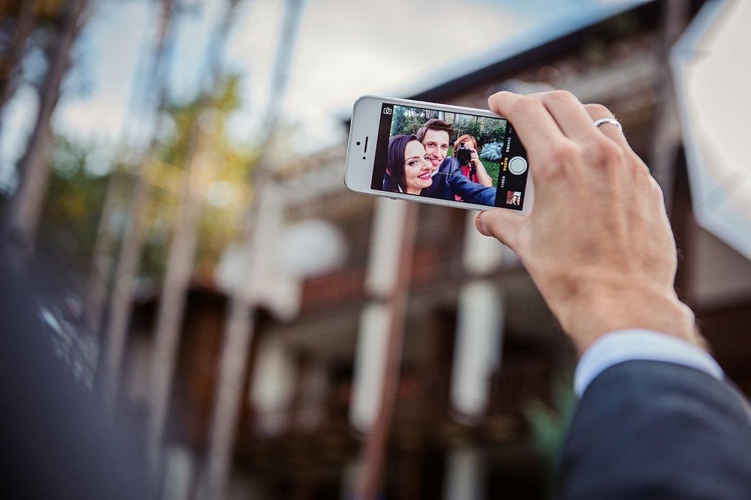 Wedding couple seflie on a phone