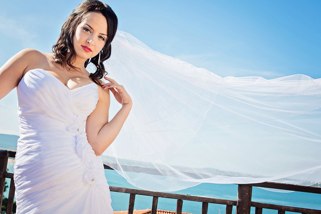 Bridal portrait near the sea with the veil