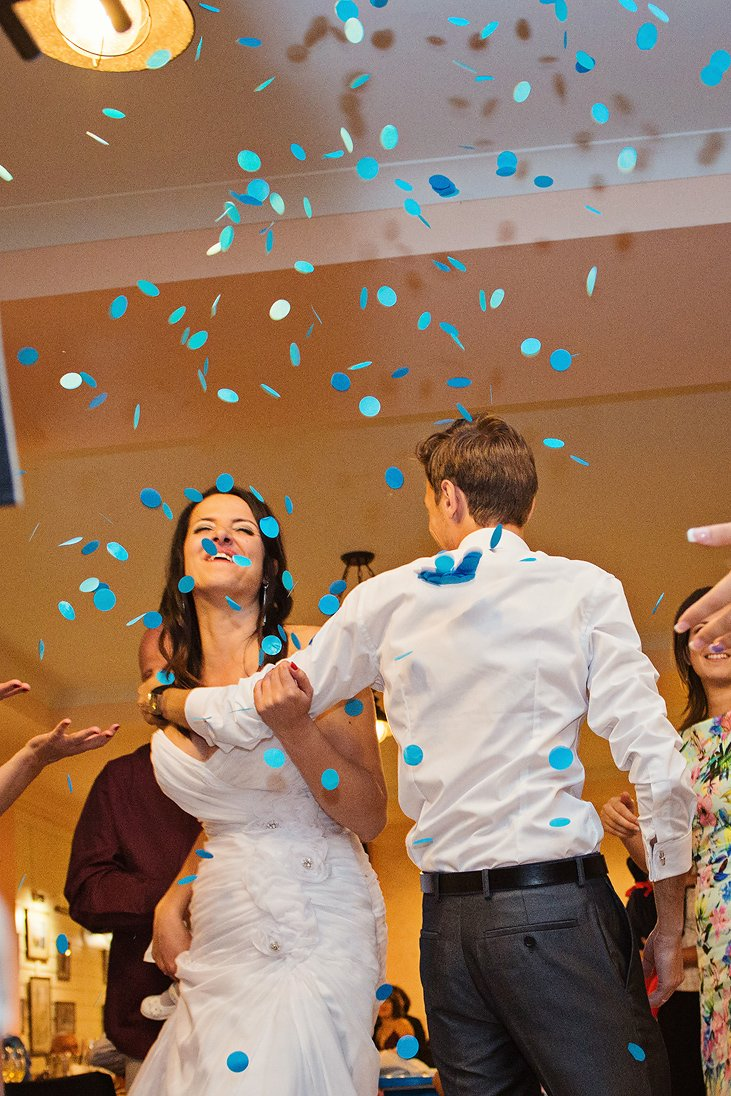 Bride and groom dancing and blue confetti