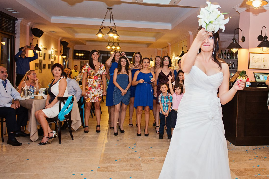Bride tossing the wedding bouquet