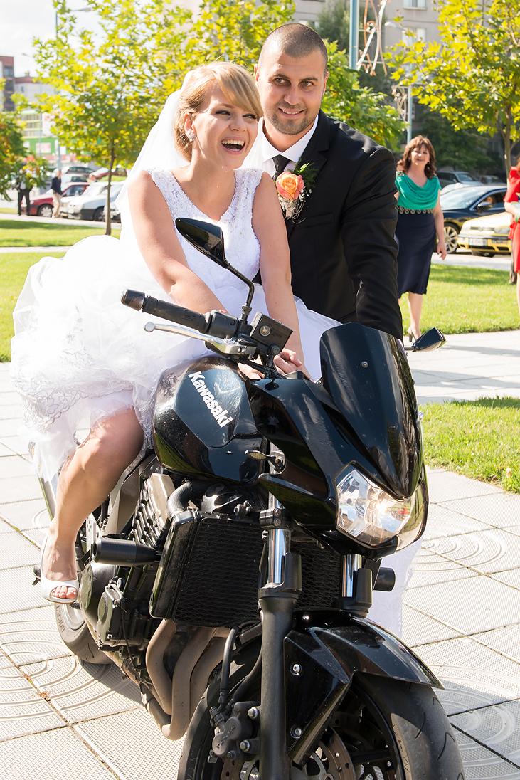 Bride on a Kawasaki motorcycle