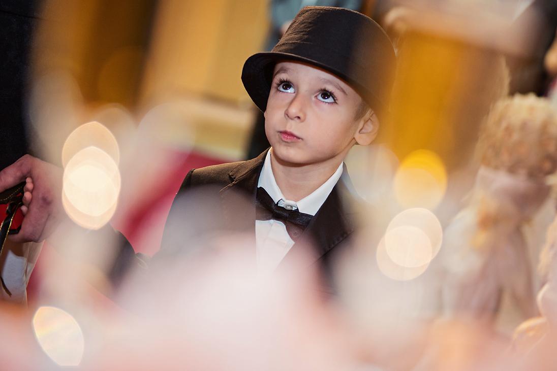 Stylish boy in black on a wedding ritual