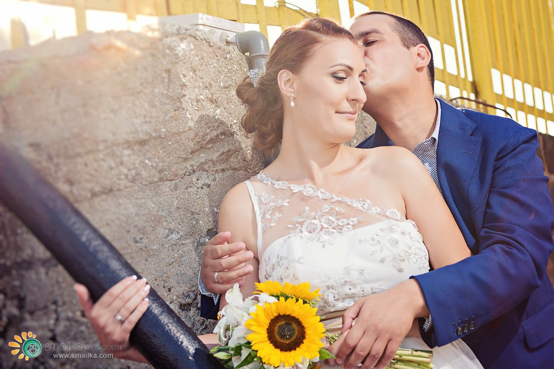 Wedding couple portrait with a sunflower
