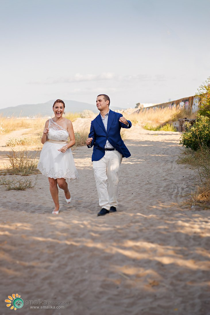 Wedding couple dancing on the beach