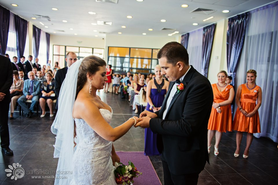 Milena Nikolay Putting rings Wedding photography