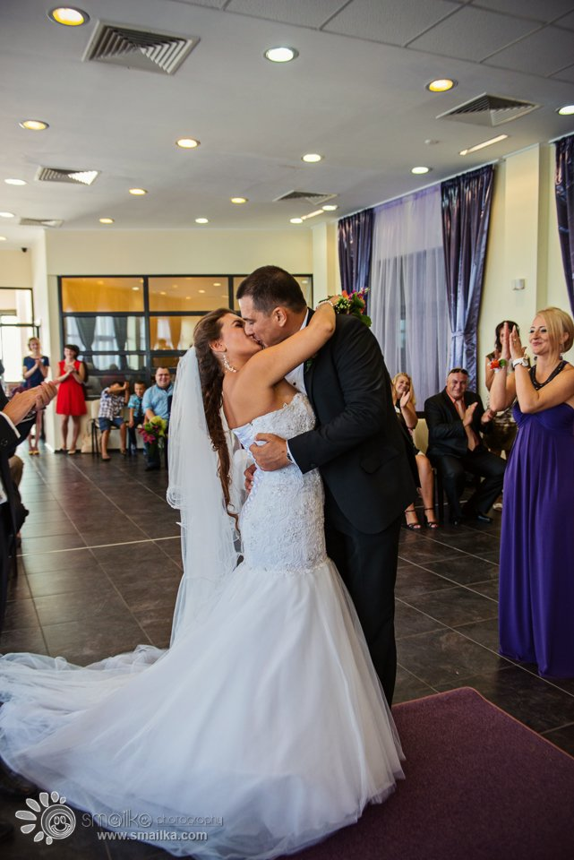 Wedding couple a first kiss photo civil ritual