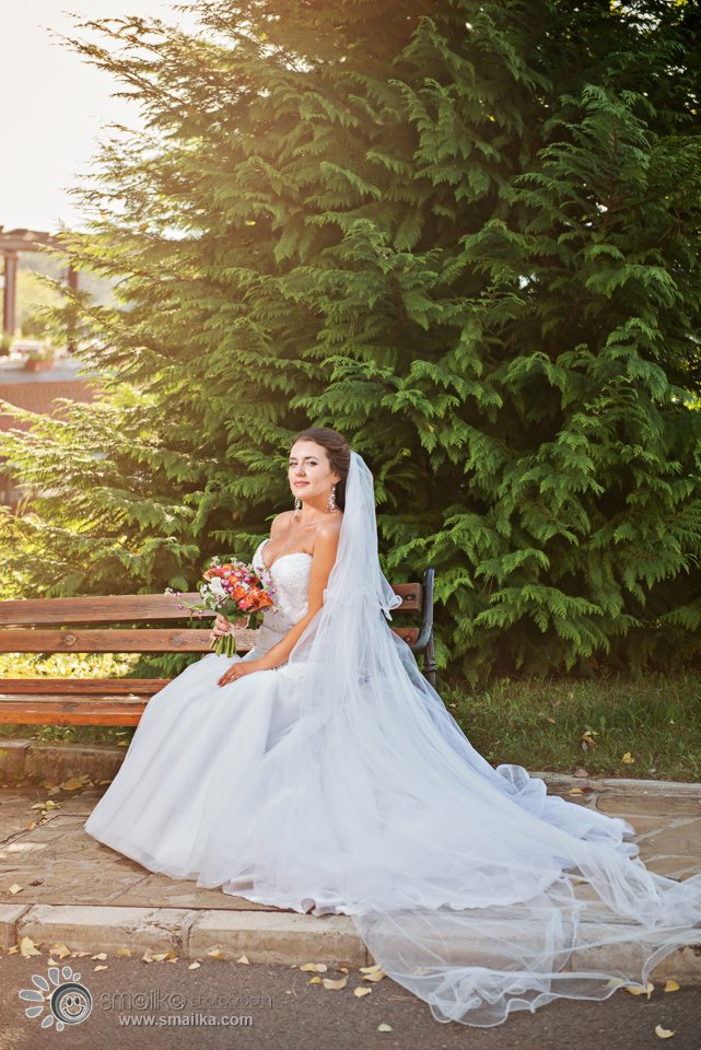 Wedding photography bridal portrait on a bench
