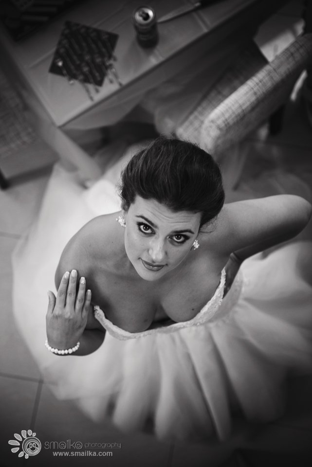A black and white photo of a bride from above