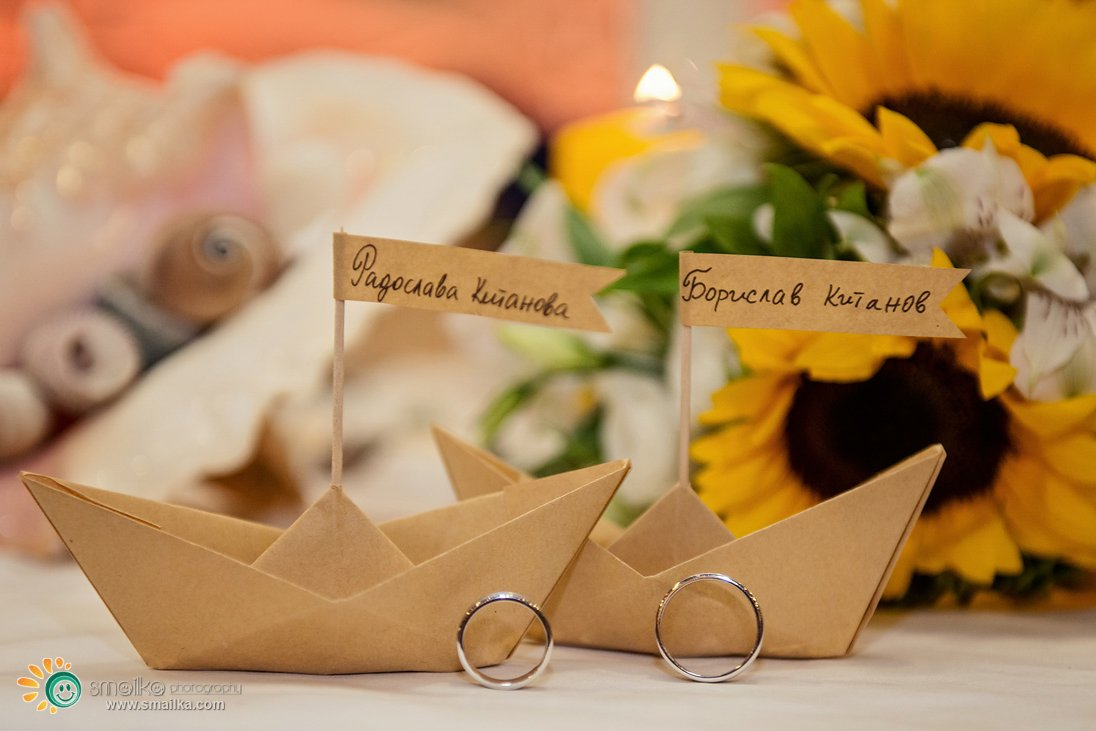 Wedding decoration paper boats and wedding rings