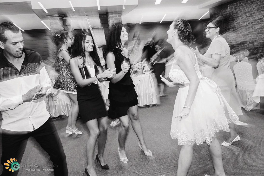 Wedding party guests dancing black and white