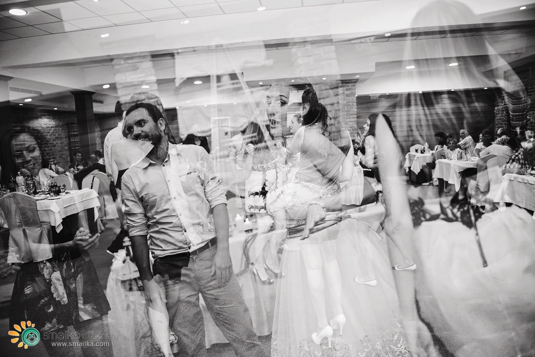 Wedding party guests dancing multiple exposure