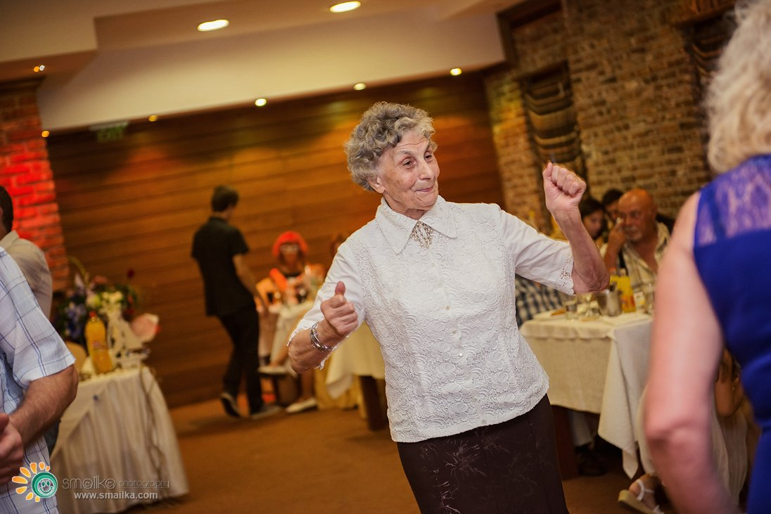 Wedding party a woman of age dancing happily