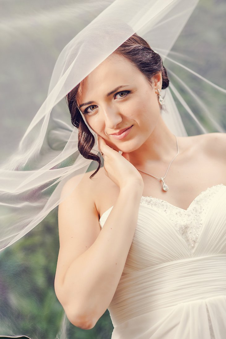 Bridal close-up portrait under the veil