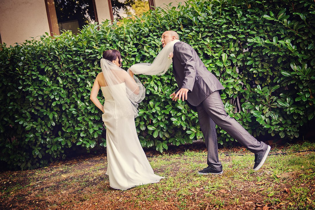 Funny wedding photo session in the nature