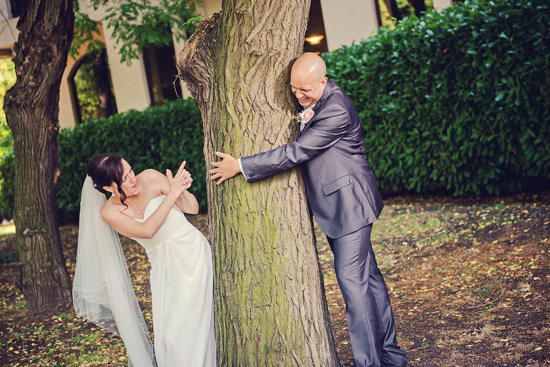 Bride and groom playing in an outdoor wedding photosession