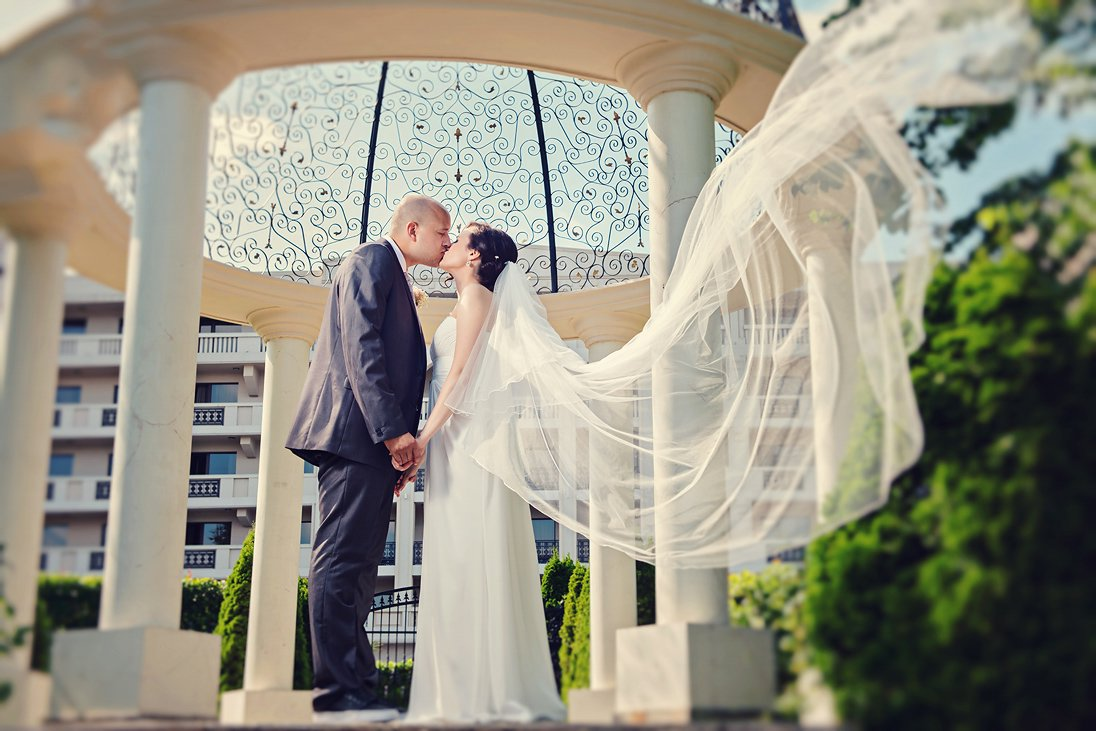 Wedding photo session under an arc