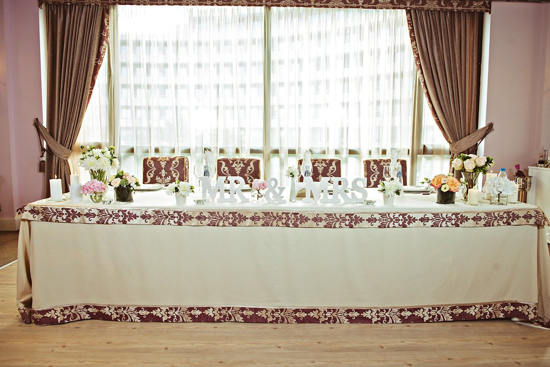 Wedding reception decorations and detail table of the newlyweds