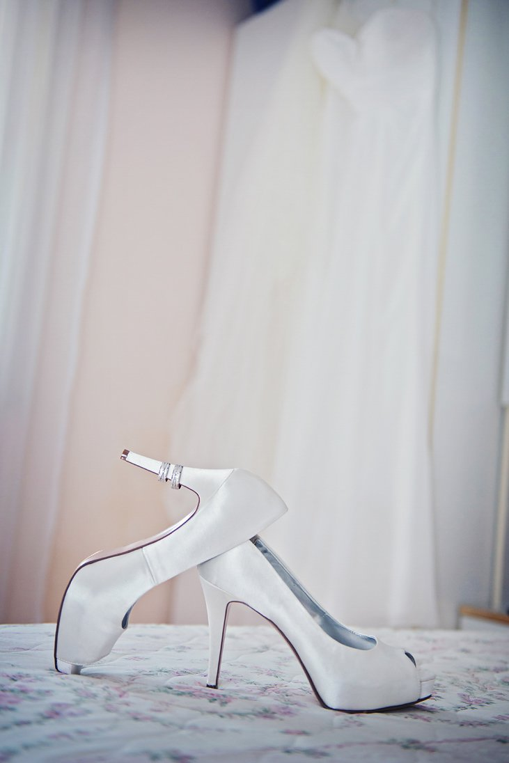 Bride shoes, wedding rings, wedding dress
