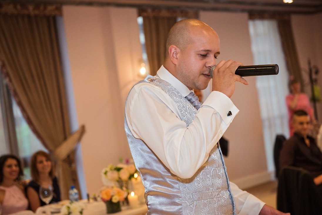 Best man singing on the wedding