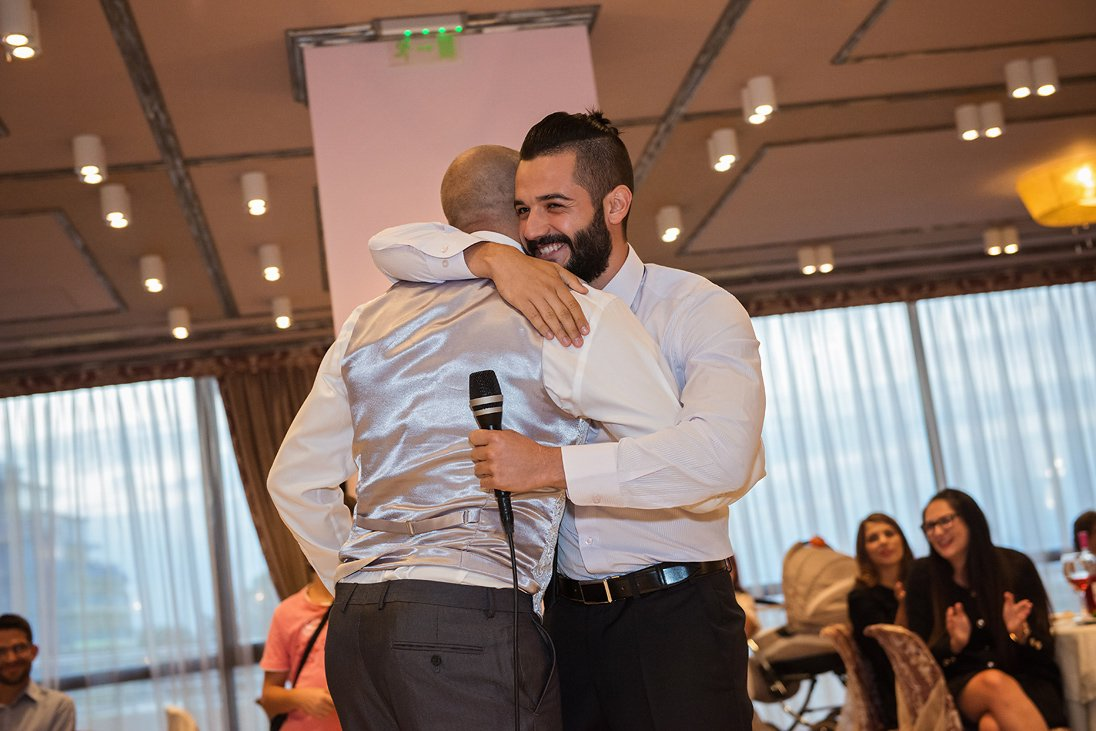 Best man and Iskrata hugging