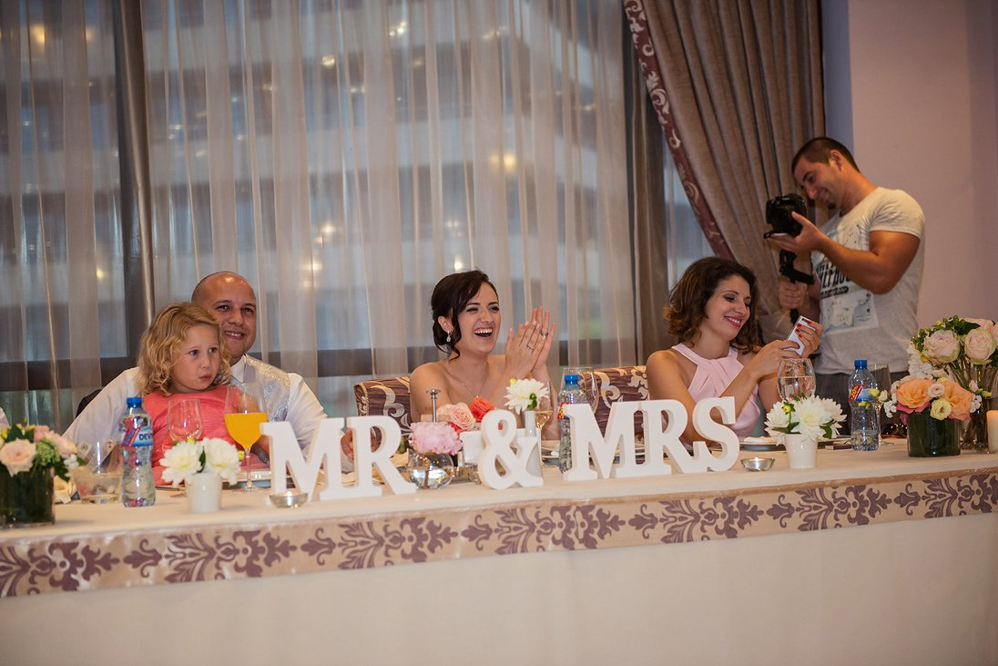 Mr and Mrs on their wedding table