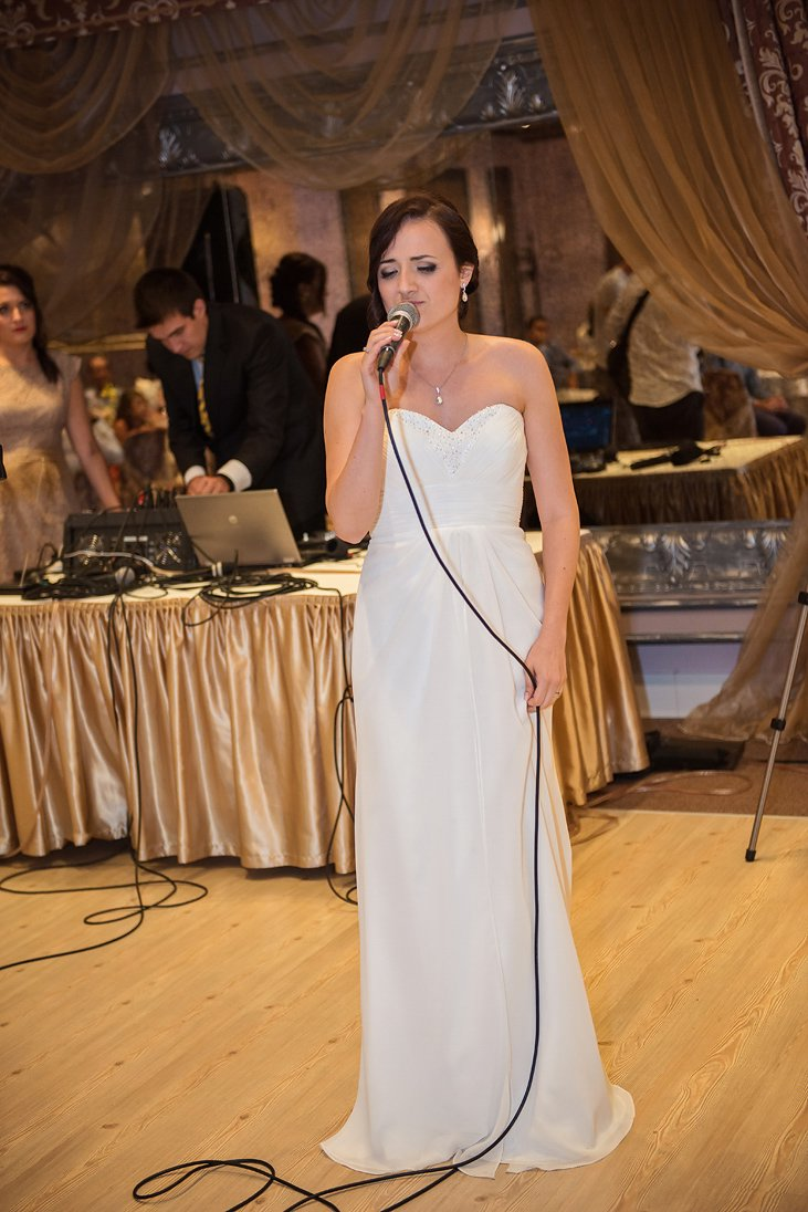 The bride sings on her wedding