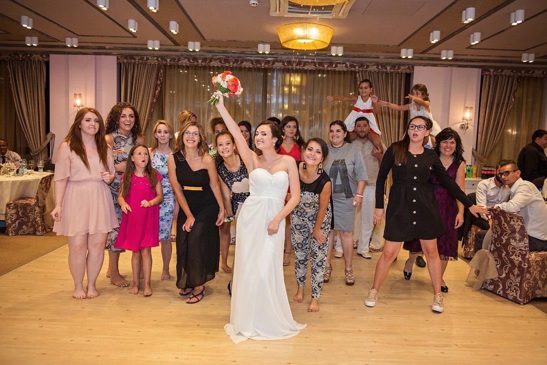 Bride tossing the wedding bouquet