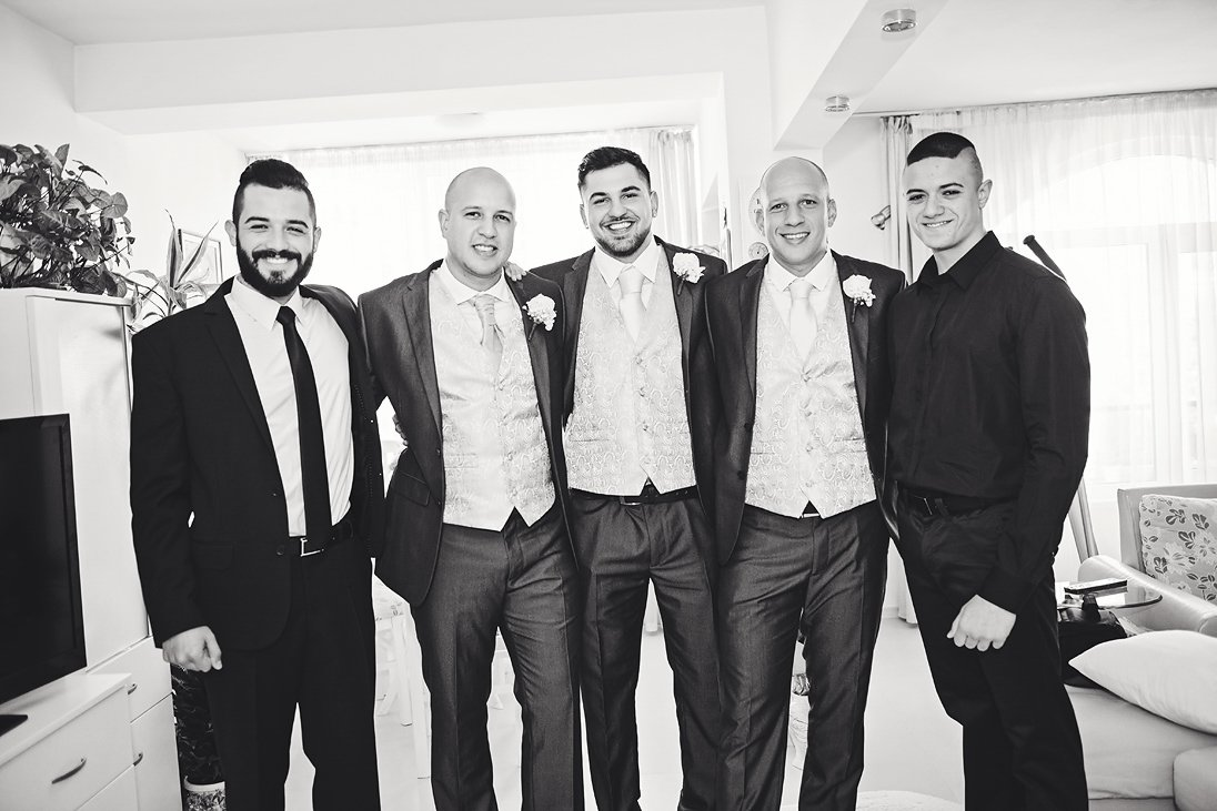 A group photo of the groom and best men