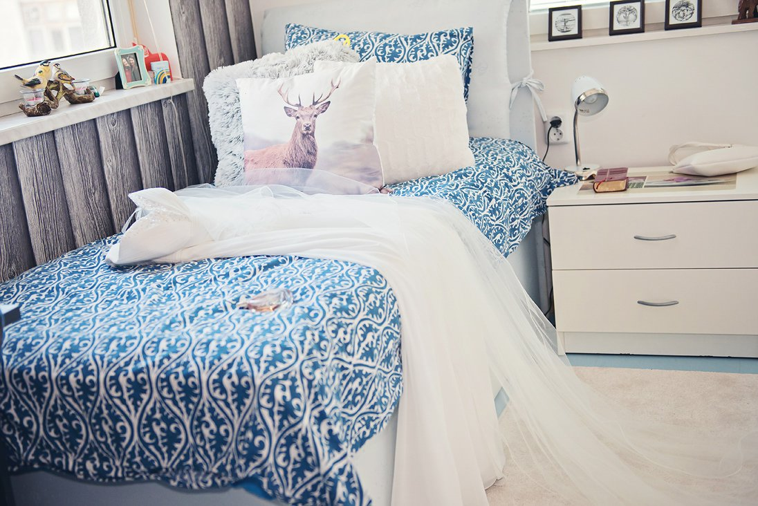 Wedding dress on a bed