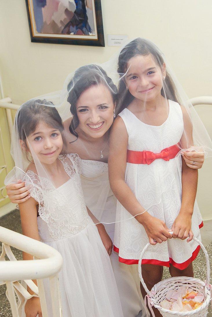 Bride and children under a wedding veil
